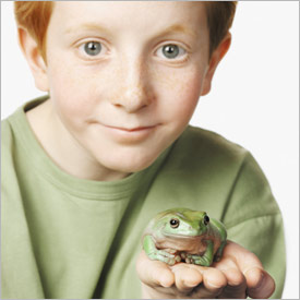 Boy with pet frog
