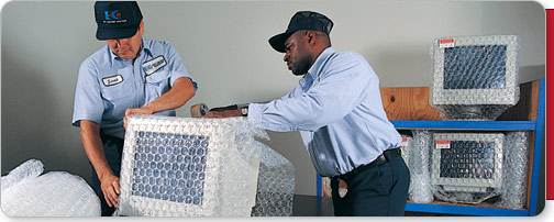 EDC employees packing computer monitors